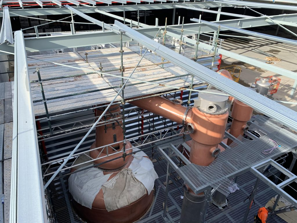 Scaffold deck over beer distillery